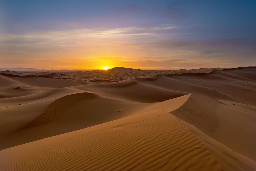 Enjoying the sunset from the dunes in the Sahara desert:This two nights in the Desert trip begins at evening, from your accommodation. The trek will start right into the desert for 1:30min